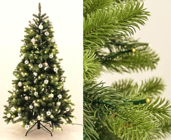 Tannenbaum mit Spritzguss Nadeln LED Beleuchtung und silbernen Kugeln 180cm